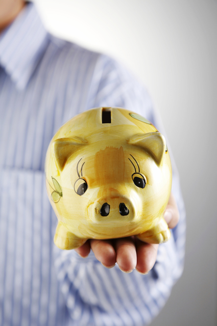 man showing a piggy bank